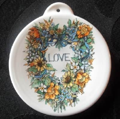 pottery ornament with floral wreath and Love decal
